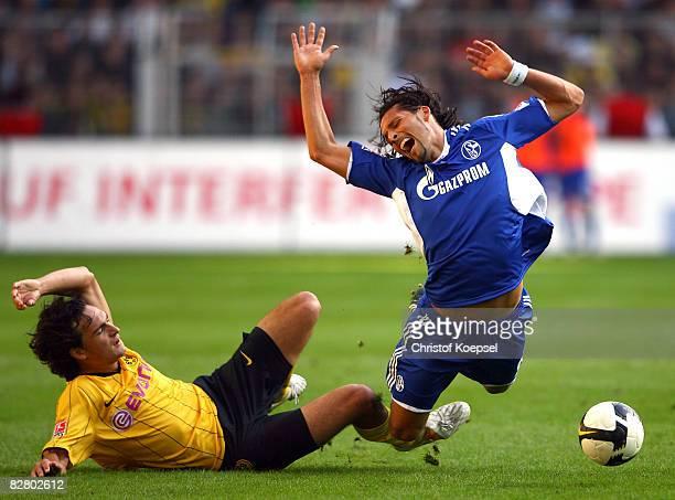 Mats Hummels of Dortmund fouls Kevin Kuranyi of Schalke during the Bundesliga match between Borussia Dortmund and FC Schalke 04 at the Signal Iduna...
