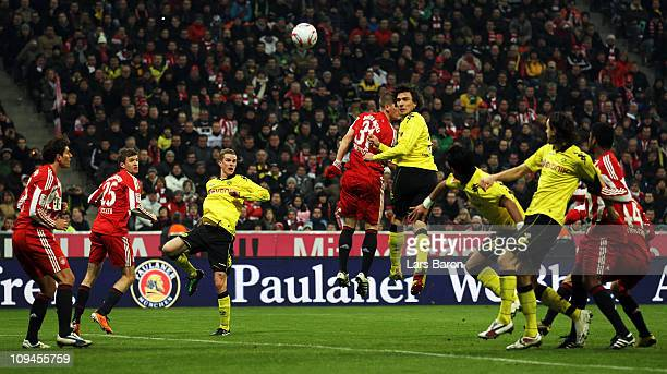 Mats Hummels of Dortmund heads his teams third goal past Bastian Schweinsteiger od Muenchen during the Bundesliga match between FC Bayern Muenchen...