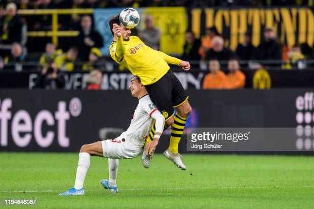 Mats Hummels of Dortmund is challenged by Yussuf Poulsen of Leipzig during the Bundesliga match between Borussia Dortmund and RB Leipzig at Signal...