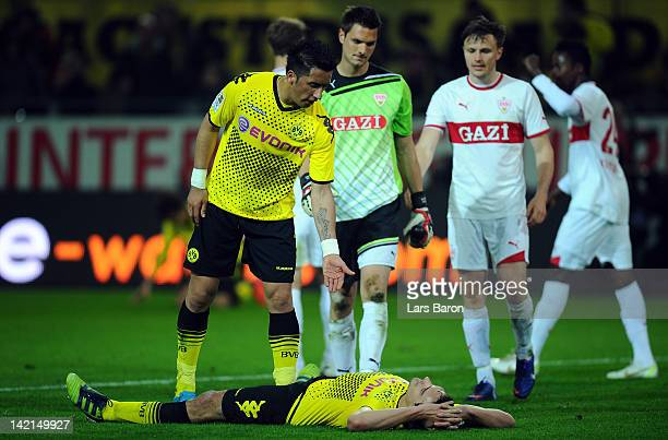 Mats Hummels of Dortmund lies dejected on the pitch after the Bundesliga match between Borussia Dortmund and VfB Stuttgart at Signal Iduna Park on...