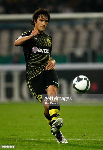 Mats Hummels of Dortmund passes the ball during the DFB Cup second round match between Karlsruher SC and Borussia Dortmund at the Wildpark Stadium on...