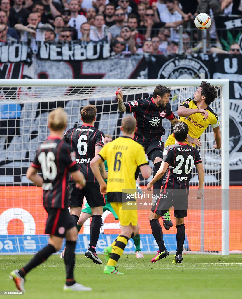 Mats Hummels of Dortmund scores a disallowed goal with a header against Marco Russ of Frankfurt during the Bundesliga match between Eintracht Frankfurt and Borussia Dortmund at Commerzbank-Arena on May 07, 2016 in Frankfurt am Main.