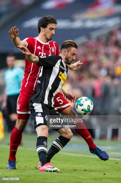 Mats Hummels of FC Bayern Muenchen and Josip Drmic of Borussia Moenchengladbach battle for the ball during the Bundesliga match between FC Bayern...