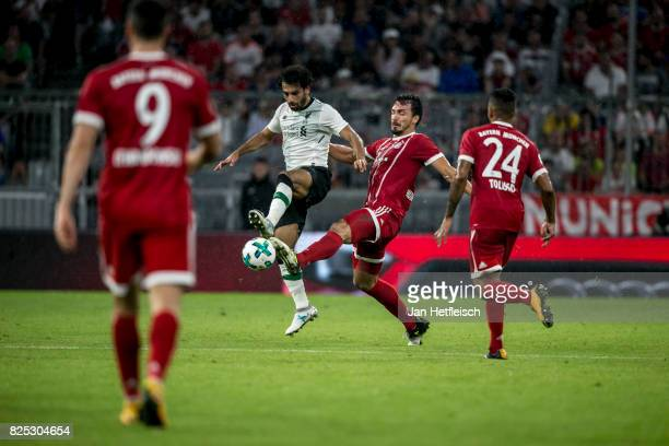 Mats Hummels of FC Bayern Muenchen and Mohamed Salah of FC Liverpool fight for the ball during the Audi Cup 2017 match between Bayern Muenchen and...
