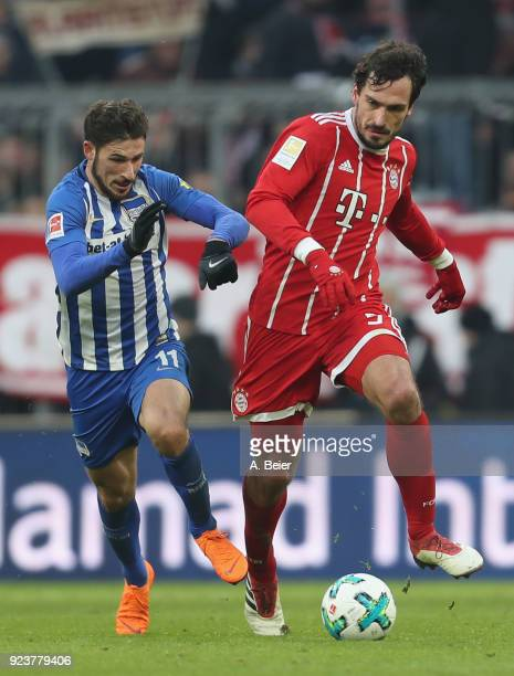 Mats Hummels of FC Bayern Muenchen fights for the ball with Mathew Leckie of Hertha BSC during the Bundesliga match between FC Bayern Muenchen and...