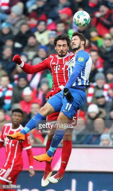 Mats Hummels of FC Bayern Muenchen heads for the ball with Mathew Leckie of Hertha BSC during the Bundesliga match between FC Bayern Muenchen and...