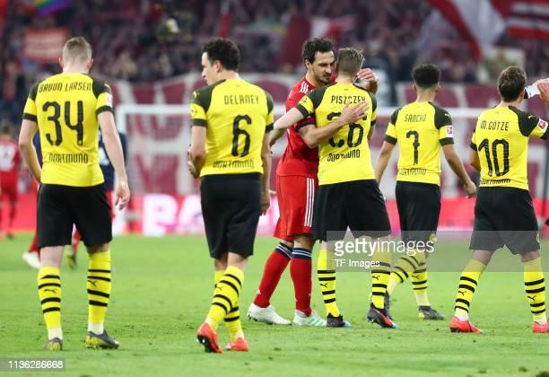 Mats Hummels of FC Bayern Muenchen hugs Lukasz Piszczek of Borussia Dortmund Jacob Bruun Larsen of Borussia Dortmund Thomas Delaney of Borussia...
