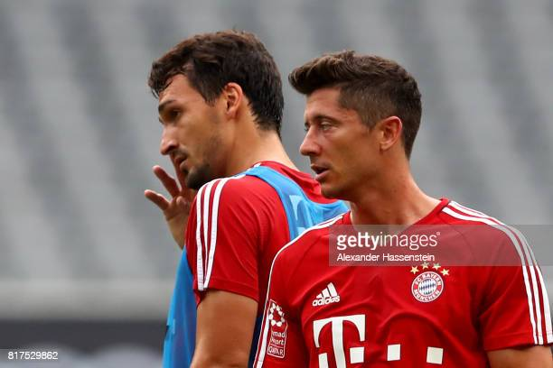 Mats Hummels of FC Bayern Muenchen looks on with his team mate Robert Lewadowski during a training session at Shanghai Stadium of the Audi Summer...