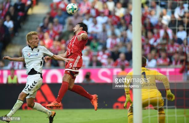 Mats Hummels of FC Bayern Munich in action against Philipp Lienhart of SC Freiburg during the Bundesliga soccer match between FC Bayern Munich and SC...