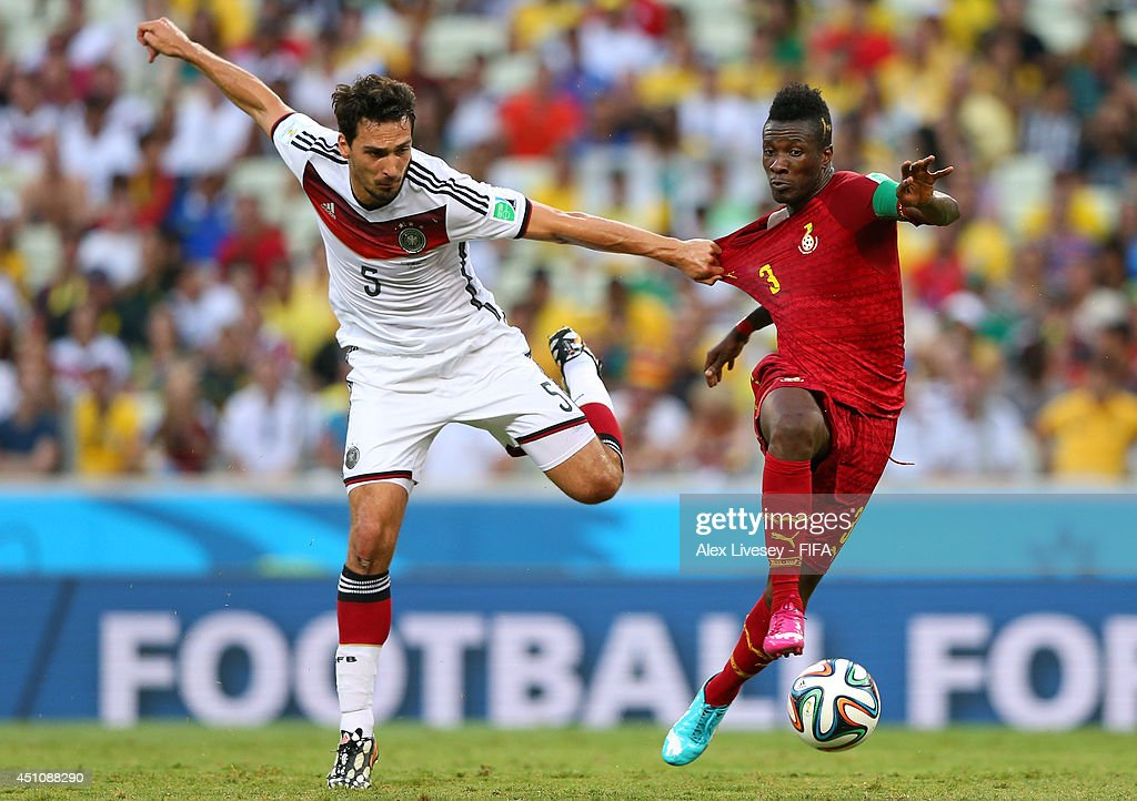 Mats Hummels of Germany and Asamoah Gyan of Ghana compete for the ball during the 2014 FIFA World Cup Brazil Group G match between Germany and Ghana at Castelao on June 21, 2014 in Fortaleza, Brazil.