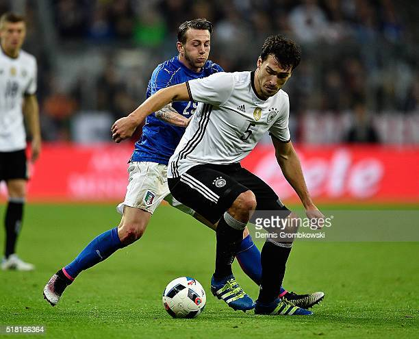 Mats Hummels of Germany and Federico Bernardeschi of Italy battle for the ball during the International Friendly match between Germany and Italy at...