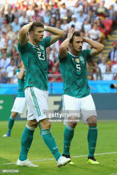 Mats Hummels of Germany and his team mate Mario Gomez react during the 2018 FIFA World Cup Russia group F match between Korea Republic and Germany at...