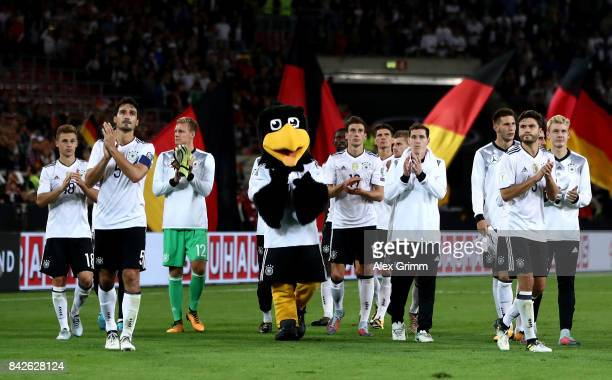 Mats Hummels of Germany and his team mates celebrate with their fans after winning the FIFA 2018 World Cup Qualifier between Germany and Norway at...