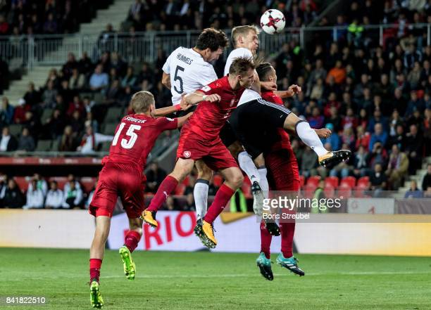 Mats Hummels of Germany and Matthias Ginter of Germany jumps for a header with players of Czech Republic during the FIFA 2018 World Cup Qualifier...