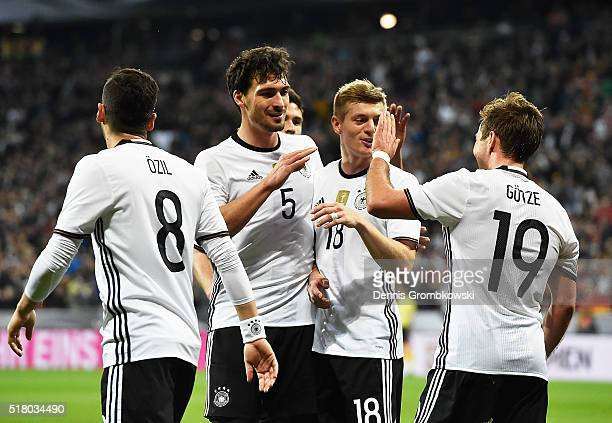 Mats Hummels of Germany and Toni Kroos of Germany congratulate Mario Goetze after he scored the second goal during the International Friendly match...