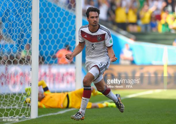 Mats Hummels of Germany celebates scoring his team's first goal during the 2014 FIFA World Cup Brazil Quarter Final match between France and Germany...