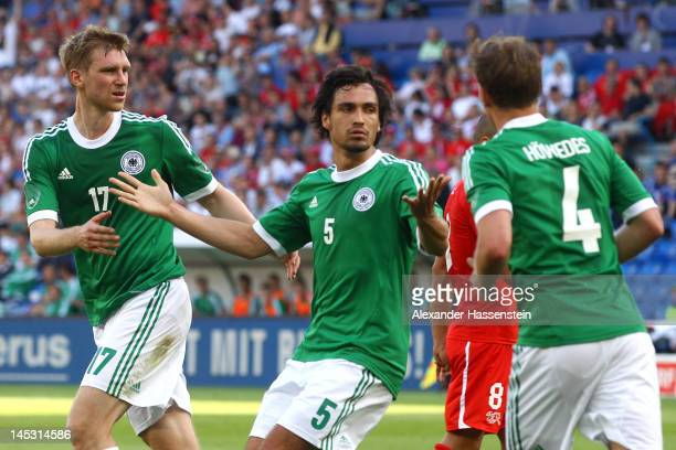 Mats Hummels of Germany celebrates scoring his first team goal with his team mates Per Mertesacker and Bendikt Hoewedes during the international...