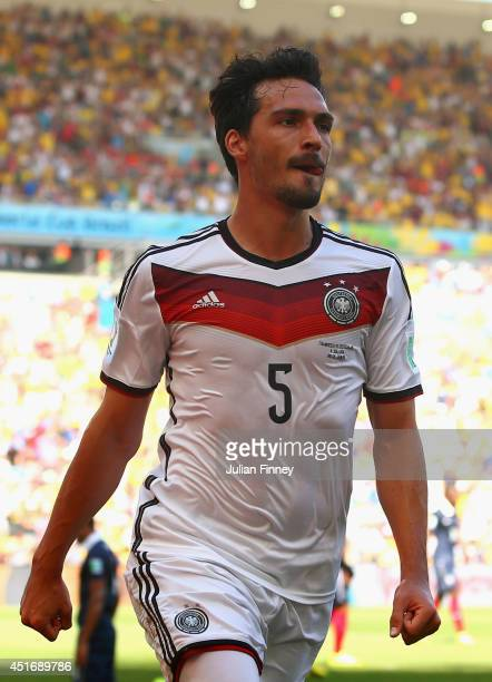Mats Hummels of Germany celebrates scoring his team's first goal during the 2014 FIFA World Cup Brazil Quarter Final match between France and Germany...
