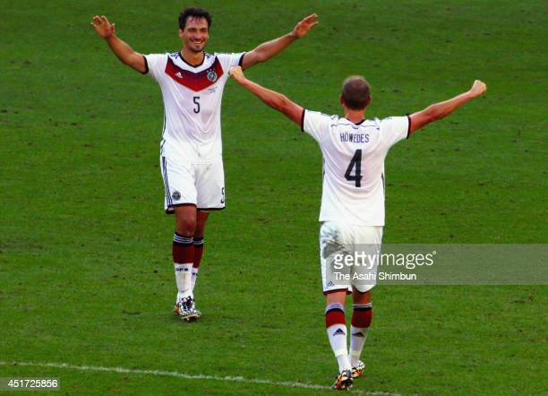 Mats Hummels of Germany celebrates the 10 win with his teammate Benedikt Hoewedes after the 2014 FIFA World Cup Brazil Quarter Final match between...