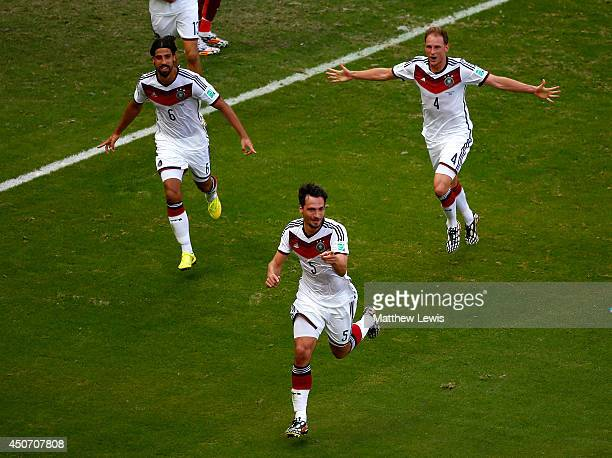 Mats Hummels of Germany celebrates with teammates Sami Khedira and Benedikt Hoewedes after scoring his team's second goal during the 2014 FIFA World...