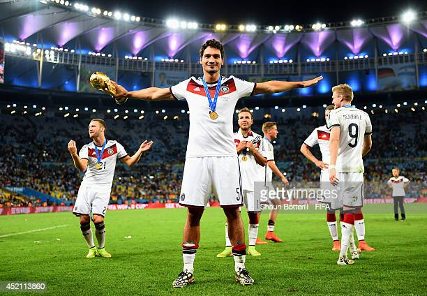 Mats Hummels of Germany celebrates with the World Cup trophy after the 2014 FIFA World Cup Brazil Final match between Germany and Argentina at...