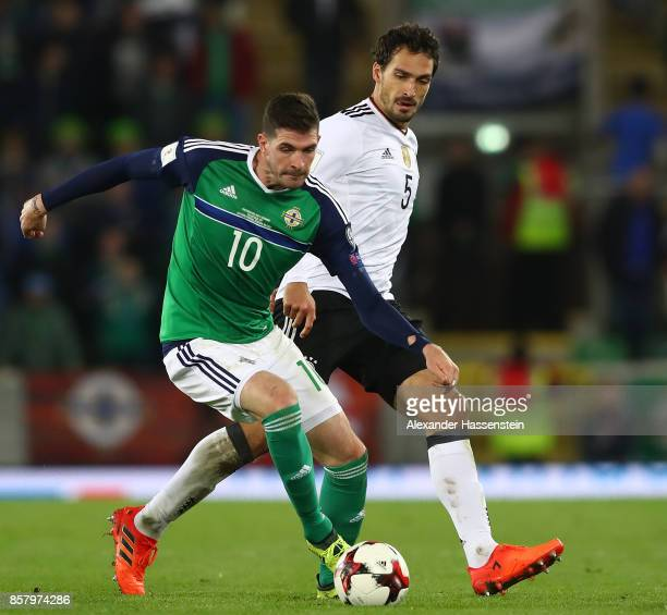 Mats Hummels of Germany challenges Kyle Lafferty of Northern Ireland during the FIFA 2018 World Cup Qualifier between Northern Ireland and Germany at...
