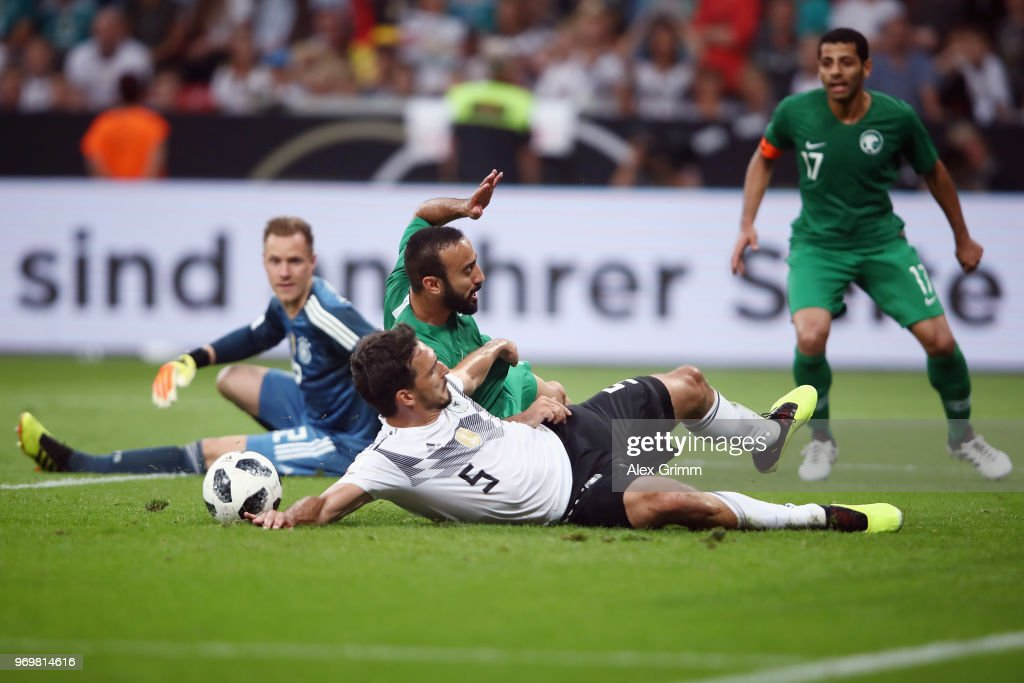 Mats Hummels of Germany clears the ball ahead of Mohammad Al-Sahlawi of Saudi Arabia during the international friendly match between Germany and Saudi Arabia ahead of the FIFA World Cup Russia 2018 at BayArena on June 8, 2018 in Leverkusen, Germany.