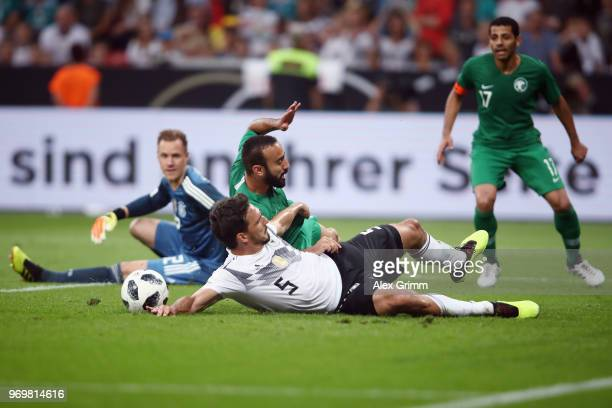 Mats Hummels of Germany clears the ball ahead of Mohammad AlSahlawi of Saudi Arabia during the international friendly match between Germany and Saudi...