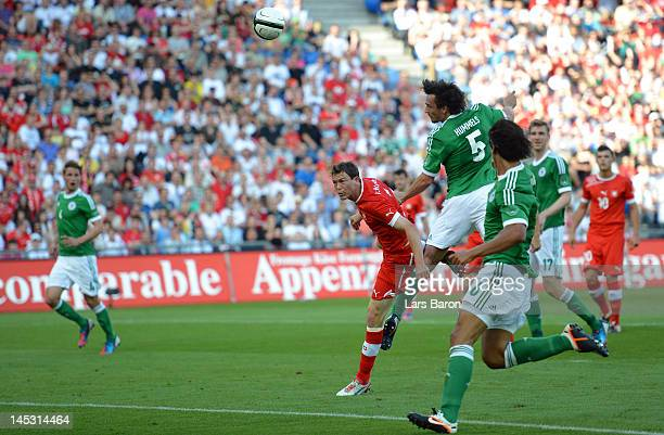 Mats Hummels of Germany heads his teams first goal during the international friendly match between Switzerland and Germany at St JakobPark on May 26...