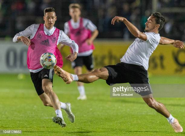 Mats Hummels of Germany is challenged by Julian Draxler of Germany during a training session of the German national team at Stadion auf dem Wurfplatz...