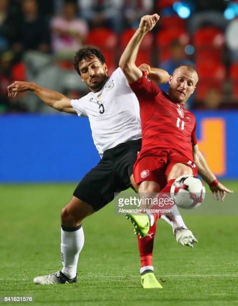 Mats Hummels of Germany is challenged by Michael Krmencik of Czech Republik during the FIFA World Cup Russia 2018 Group C Qualifier between Czech...