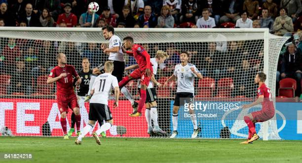 Mats Hummels of Germany jumps for a header with Theodor Gebre Selassie of Czech Republic during the FIFA 2018 World Cup Qualifier between Czech...