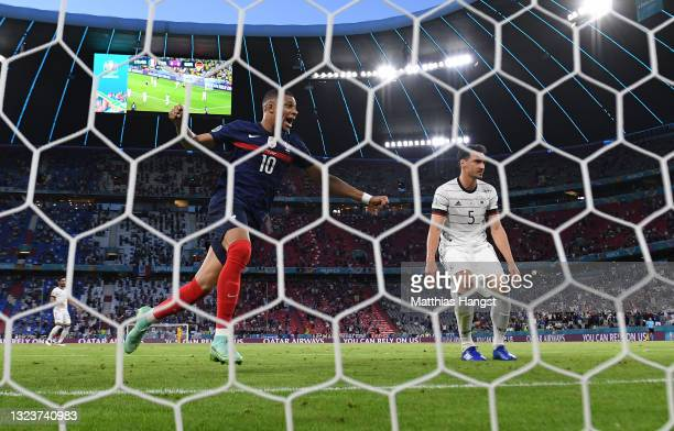Mats Hummels of Germany looks dejected after scoring an own goal for France's first goal as Kylian Mbappe of France celebrates during the UEFA Euro...