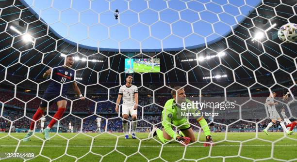 Mats Hummels of Germany looks dejected after scoring an own goal past team mate Manuel Neuer as Kylian Mbappe of France celebrates during the UEFA...