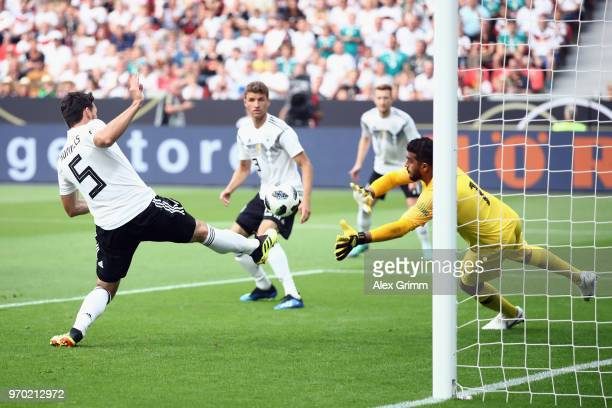 Mats Hummels of Germany misses a chance to score against goalkeeper Abdullah AlMayouf of Saudi Arabia during the international friendly match between...