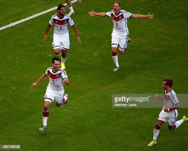 Mats Hummels of Germany Sami KhediraBenedikt Hoewedes and Mario Goetze celebrate their team's second goal during the 2014 FIFA World Cup Brazil Group...