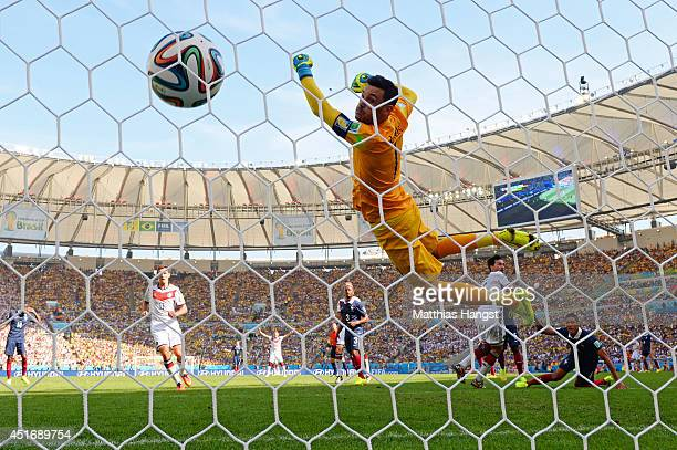 Mats Hummels of Germany scores his team's first goal past Hugo Lloris of France during the 2014 FIFA World Cup Brazil Quarter Final match between...