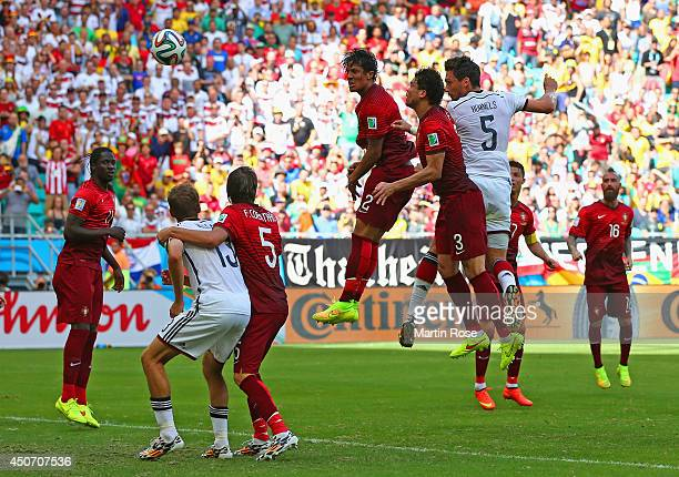 Mats Hummels of Germany scores on a header for his team's second goal against Bruno Alves and Pepe of Portugal during the 2014 FIFA World Cup Brazil...