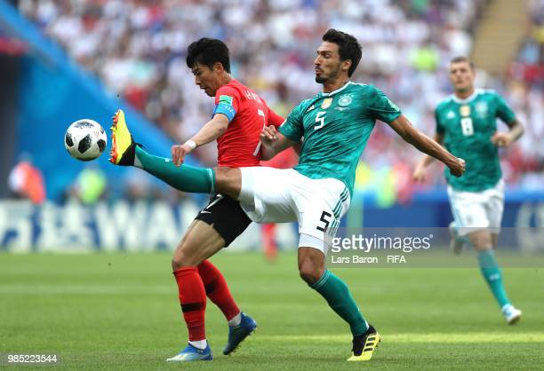 Mats Hummels of Germany tackles Heungmin Son of Korea Republic during the 2018 FIFA World Cup Russia group F match between Korea Republic and Germany...