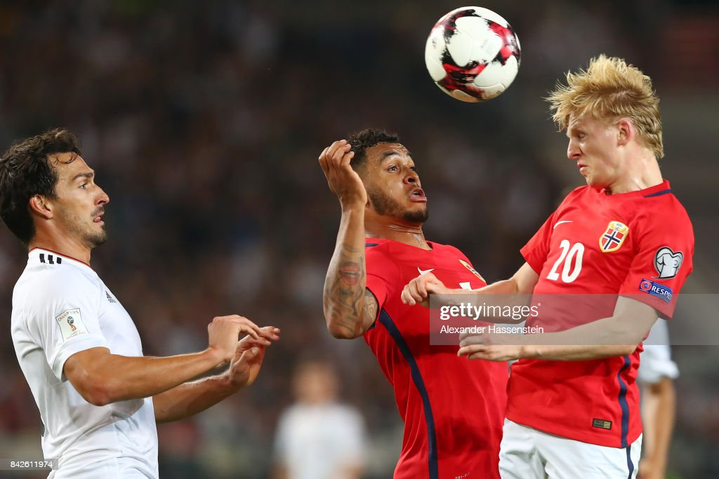 Mats Hummels of Germany (l) watches as Joshua King of Norway (c) and Mats Moller Daehli of Norway (r) try to get the ball during the FIFA 2018 World Cup Qualifier between Germany and Norway at Mercedes-Benz Arena on September 4, 2017 in Stuttgart, Baden-Wuerttemberg.