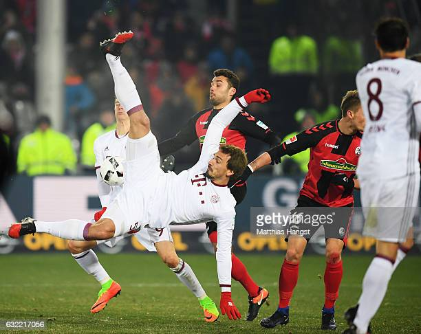 Mats Hummels of Muechen attempts an overhead kick during the Bundesliga match between SC Freiburg and Bayern Muenchen at SchwarzwaldStadion on...