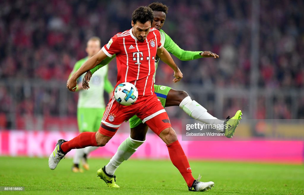 Mats Hummels (front) of Muenchen and Divock Origi of Wolfsburg battle for the ball during the Bundesliga match between FC Bayern Muenchen and VfL Wolfsburg at Allianz Arena on September 22, 2017 in Munich, Germany.