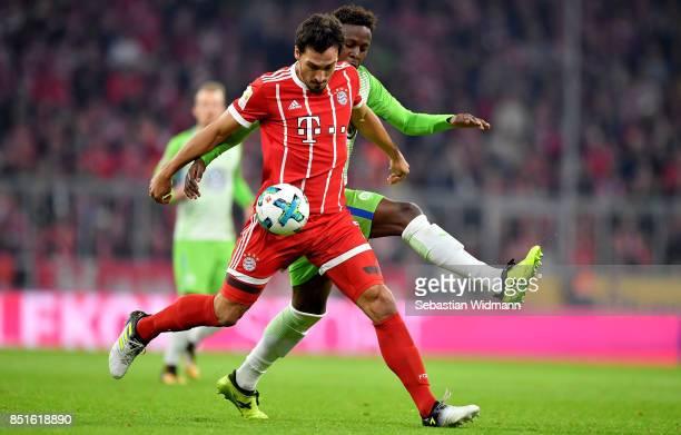 Mats Hummels of Muenchen and Divock Origi of Wolfsburg battle for the ball during the Bundesliga match between FC Bayern Muenchen and VfL Wolfsburg...