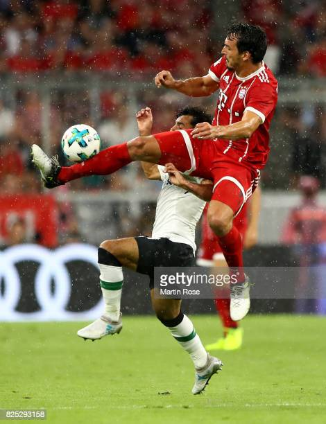 Mats Hummels of Muenchen and Mohamed Salah of Liverpool battle for the ball during the Audi Cup 2017 match between Bayern Muenchen and Liverpool FC...