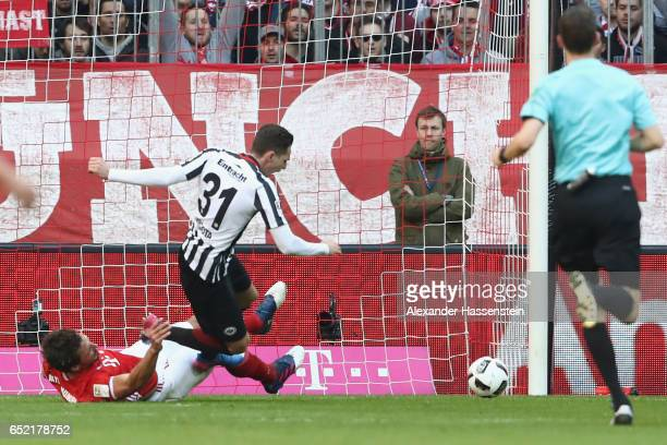 Mats Hummels of Muenchen battles for the ball with Branimir Hrgota of Frankfurt during the Bundesliga match between Bayern Muenchen and Eintracht...