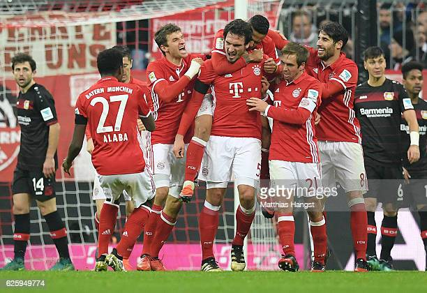 Mats Hummels of Muenchen celebrates with his teammates after scoring his team's second goal during the Bundesliga match between Bayern Muenchen and...