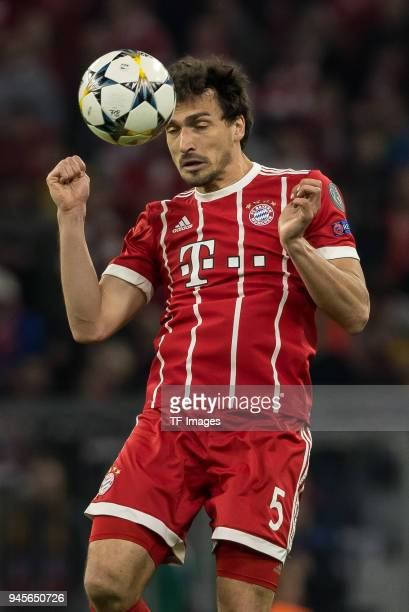 Mats Hummels of Muenchen heads the ball during the UEFA Champions League quarter final second leg match between Bayern Muenchen and Sevilla FC at...