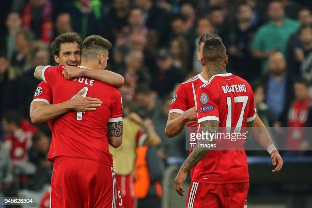 Mats Hummels of Muenchen Niklas Suele of Muenchen Sandro Wagner of Muenchen and Jerome Boateng of Muenchen celebrate after winning the UEFA Champions...