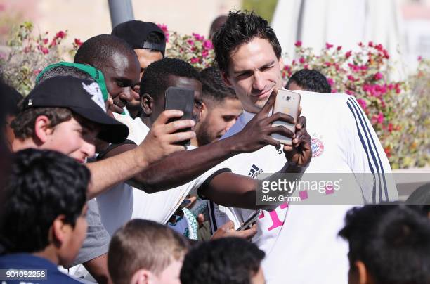Mats Hummels of Muenchen poses with fans during a training session on day 3 of the FC Bayern Muenchen training camp at ASPIRE Academy for Sports...