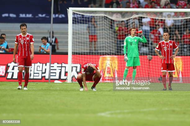 Mats Hummels of Muenchen reacts with his team mates Javier Marztinez keeper Christian Fruechtl and Rafinha after receiving the 3rd goal during the...